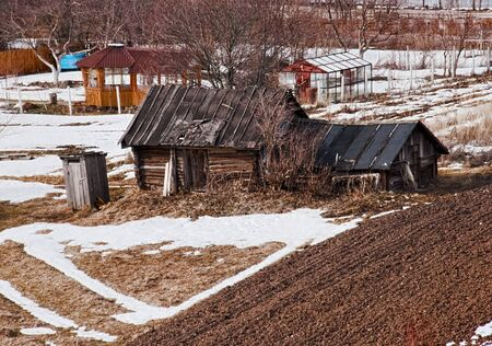 The old wooden house in the field. Russia  Stock Photo - 8388667