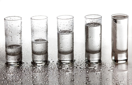 A row of glasses for vodka  photo