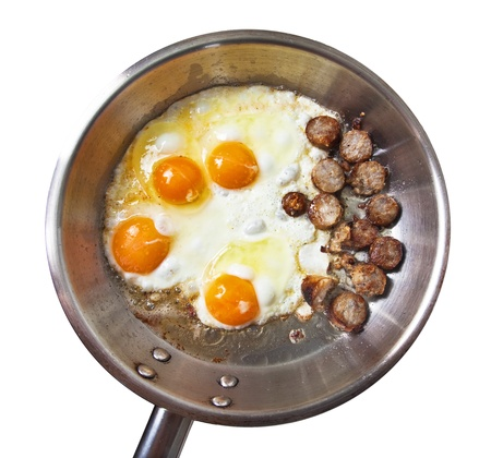 Frying pan with sausage slices and eggs Stock Photo - 8684592
