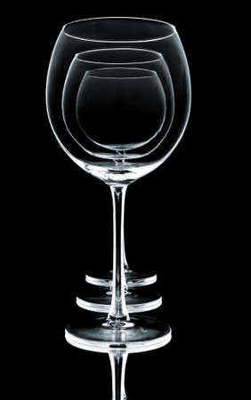 wine glasses in row on black background  photo