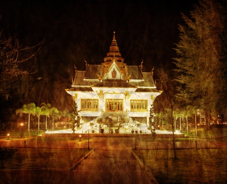 Old thai temple in retro and grunge style photo