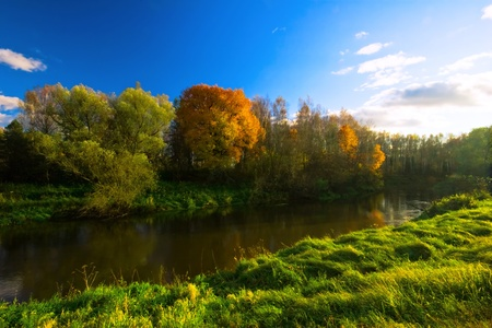 small river under blue sky.The end of summer