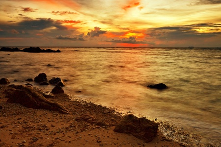 Colorful sunset at the tropical beach photo