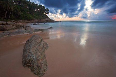 Tropical sunset at the rocks. Thailand photo