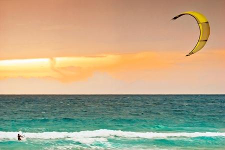 kite surf: Kite-surfing on orange sunset background .