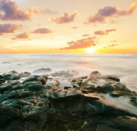 Sunset at volcanic stones beach. Big island. Hawaii photo