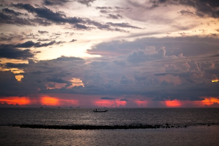 Tropical colorful sunset at the tropical beach. Thailand  photo