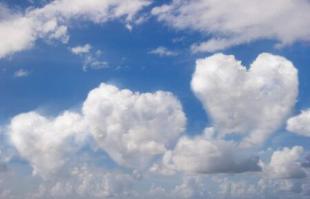 Blue sky with clouds in hearts view. photo