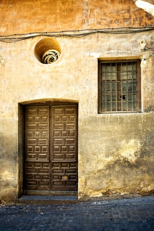 Abandoned house, Old wall with door and window on the streets of Toledo town. Spain Stock Photo - 9737058