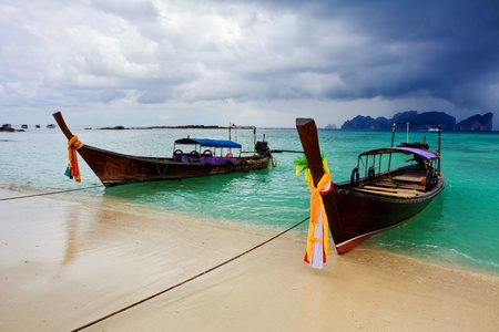 Boats in the tropical sea in stormy weather. Phi Phi island. Thailand  photo
