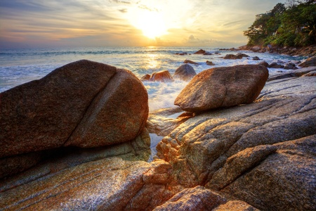 Tropical colorful sunset at the stones beach. Thailand  photo