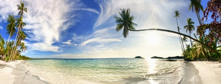 Stitched panorama of exotic tropical beach under blue sky. Thailand photo