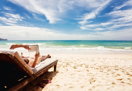 Relaxing and reading book at the beach . Thailand