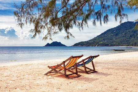 Two sun beach chairs on shore near sea  Stock Photo - 10420833