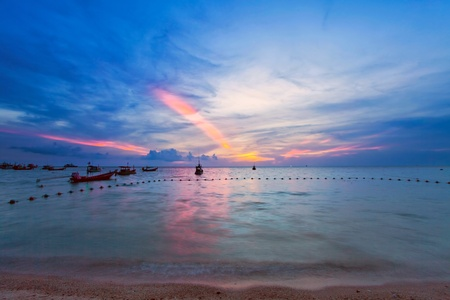 Tropical colorful sunset at the beach. Thailand photo