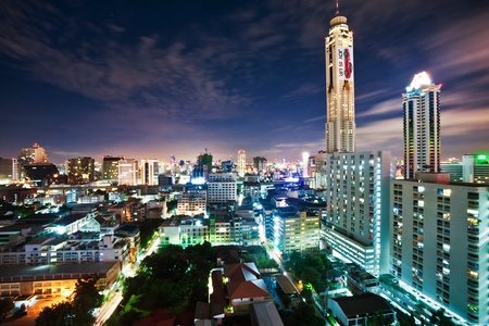 technoligy: BANGKOK - JUNE 11: A view on the night city and Bayok Sky hotel of Bangkok on 11 June 2010. Baiyoke Sky Hotel the tallest hotel in Southeast Asia and the third-tallest all-hotel structure in the world  Editorial