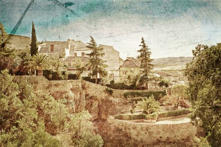 View on canyon and old city of Andalusia in Spain in grunge and retro style photo