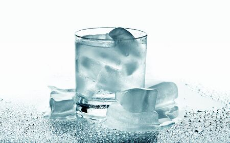 Glass with a drink and ice on a white background  photo