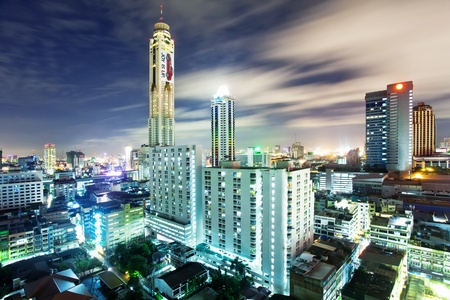 cosmopolitan: BANGKOK - JUNE 11: A view on the night city and Bayok Sky hotel of Bangkok on 11 June 2010. Baiyoke Sky Hotel the tallest hotel in Southeast Asia and the third-tallest all-hotel structure in the world  Editorial