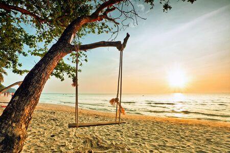 Swing on beautiful sunset at the beach Stock Photo - 11544389