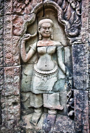 Apsara carved on the wall of Angkor Wat, Cambodia  photo