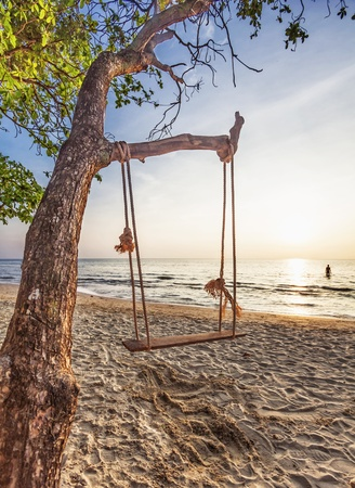 Swing on beautiful sunset at the beach Stock Photo - 12782421