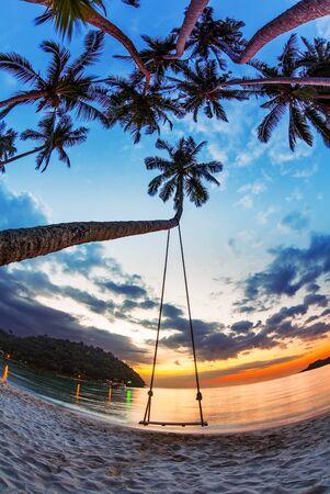 Swing on beautiful sunset at the beach  photo