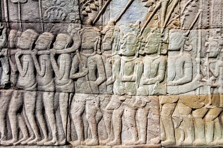 Bas-relief  carved on the wall of Angkor Wat, Cambodia  photo