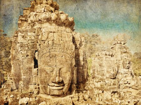 Faces of ancient Bayon Temple At Angkor Wat in retro and grunge style. Siem Reap, Cambodia  photo