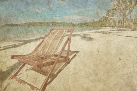 sun beach chairs on shore near sea in grunge and retro style  photo