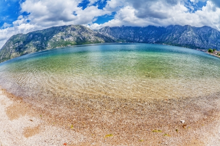 Sandy beach with sea and mountain views  fisheye look  Montenegro photo