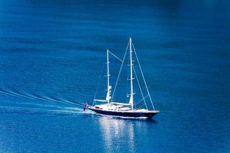 The white yacht in the blue sea photo