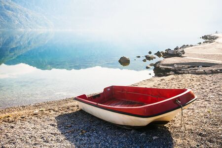 The boat on the beach early in the morning with the sea and mountains in fog Stock Photo - 14160669