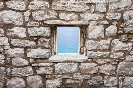 Old wall with window seaview photo
