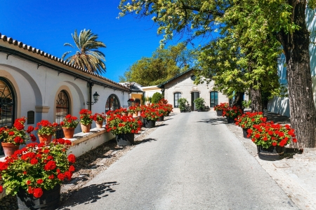 Street of old Spanish town under blue sky