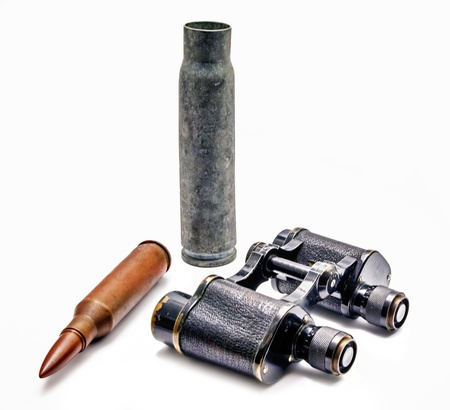 Japanese military binoculars since the First World War with bullets on a white background.  photo