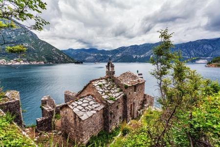 The old church overlooking the sea in bad weather. Montenegro photo