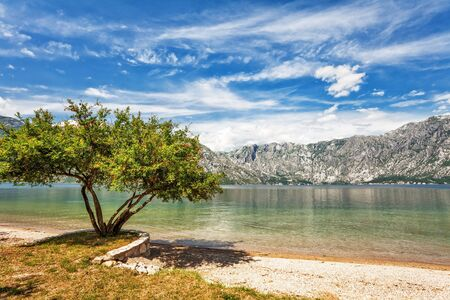 Sandy beach with sea and mountain views.  Montenegro photo