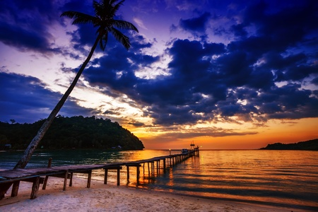 sunrise beach: Sunset over the sea  Pier on the foreground