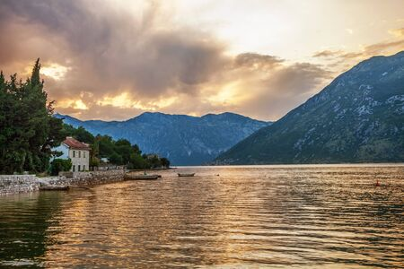 Sunset on the sea with the а foggy mountains  Montenegro photo