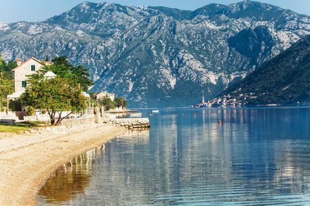 Sandy beach with sea and mountain views.  Montenegro photo