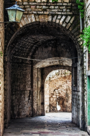 Ancient arch pathway on a Kotor old town in Montenegro  photo