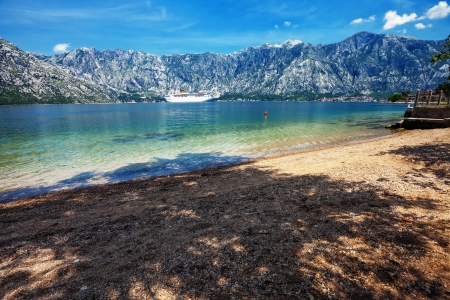 Sandy beach with sea and mountain views   Montenegro photo