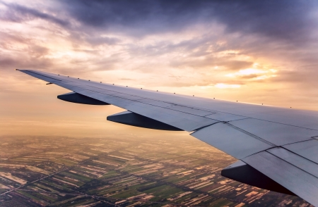 Sunset sky view over the wing of the plane