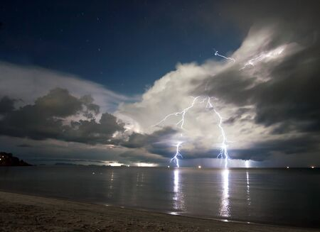 Lightning above the sea at night. Thailand  photo
