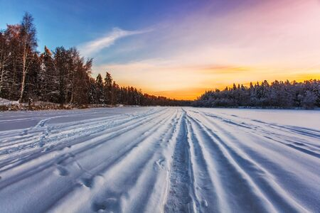 Beautiful winter sunset near the forest. Nature background. Stock Photo - 15399948