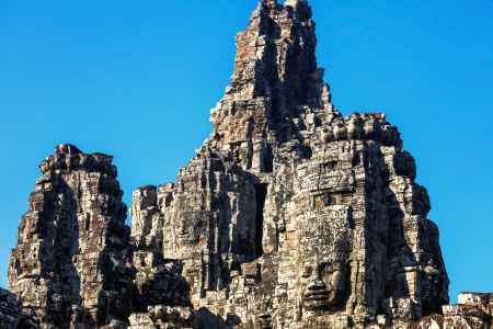 Faces of ancient Bayon Temple At Angkor Wat, Siem Reap, Cambodia  Stock Photo - 15441107