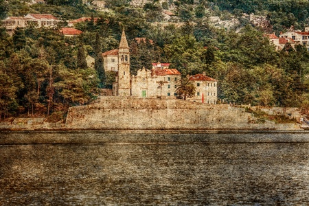 The old church on an island in the sea on moutains background in grunge and retro styles photo
