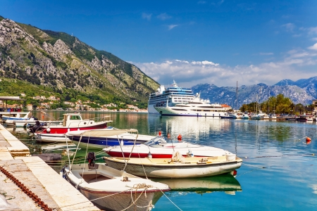 Tourist white cruise sea liner is sailing in rocky bay on the mountain background  Stock Photo - 15829719