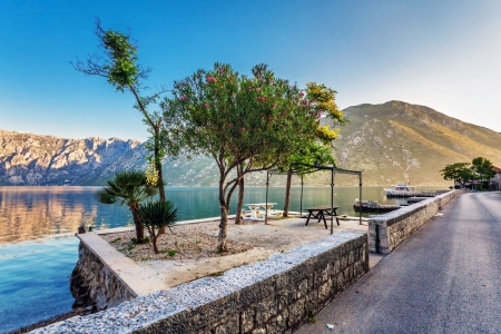 Early misty morning on the beach with sea and mountain views  Kotor bay  Montenegro Stock Photo - 15829722